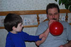 Husband and Son working on Balloon Rocket