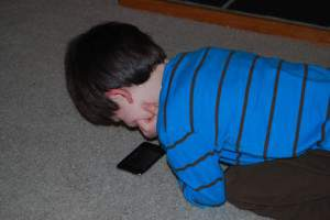 Son playing with itouch