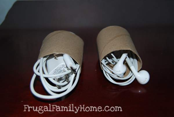 Cords rolled up in toliet paper tube