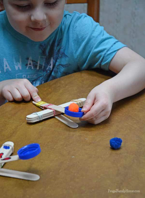 Make a cool catapult with popsicle sticks