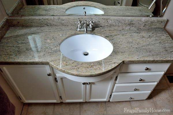 The new granite countertop is a nice neutral color with a little green and black. | Frugal Family Home