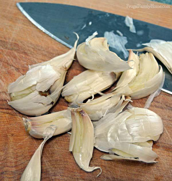 Give the garlic a good smash to get the skins to release | Frugal Family Home