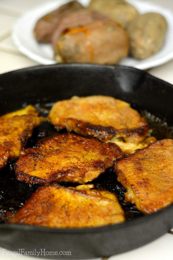Glazed pork chops cooked in a pan ready to serve.
