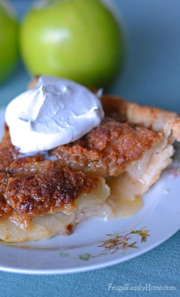 I know this time of year I love to make apple recipes. Apple pie is one of my favorite fall desserts. If you also love to enjoy apples you're going to want to give this Apple Crumble Pie Recipe a try. It has a crunchy topping over slightly tart apples that make the best pie ever.