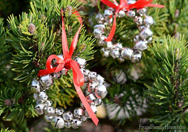 These jingle bell wreath ornaments are so easy to make and add a little jingle to you Christmas tree. You only need 4 things to make them and a few minutes to make each one. My kids helped me to make ours and they turned out great.