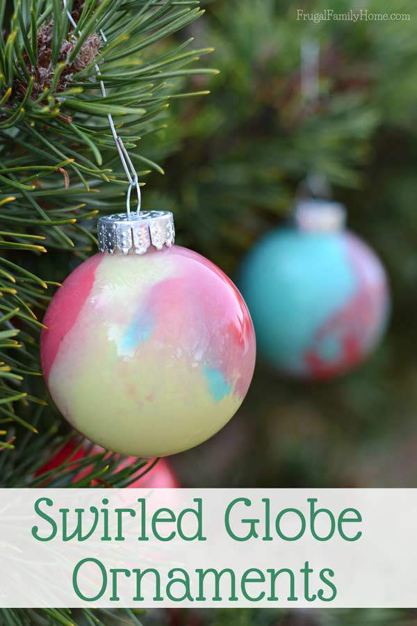 My kids had a great time making this Christmas ornaments, even though I was the one to drop and break one while it was full of paint. We used a glitter paint and watermelon red to make our swirled paint ornaments.