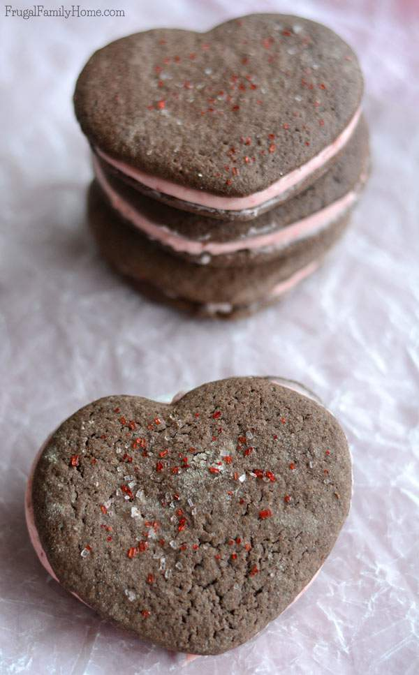 I knew I would love these cookies as soon as I saw them. I mean they are so cute but once you make them you'll see just how delicious they are too. This chocolate covered strawberry cookie recipe is so easy to make but turns out so yummy too. Great for a Valentine's Day dessert or for a Valentine's Day party. These are not your average Valentine's Day cookie.