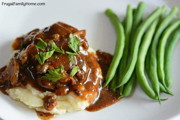 A simple and easy Salisbury steak recipe with mushroom gravy. This is an easy recipe for Salisbury steak that only takes about 30 minutes to make and costs less than $1 per serving.
