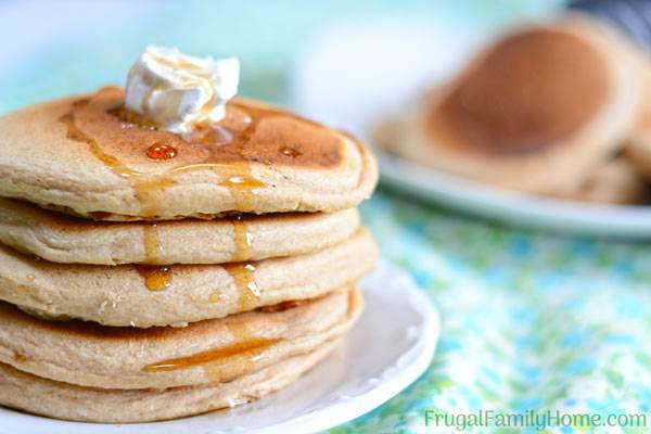 This fluffy whole wheat pancake recipe is easy to make and healthy too. It doesn't contain eggs or oil. You can make it dairy free by using almond milk or another non dairy milk. It's a great weekend breakfast but fast enough to be made on a weekday too. Even though these pancakes are made with whole wheat, they are light and fluffy. Come see what the secret is to making them fluffy instead of heavy and dense.