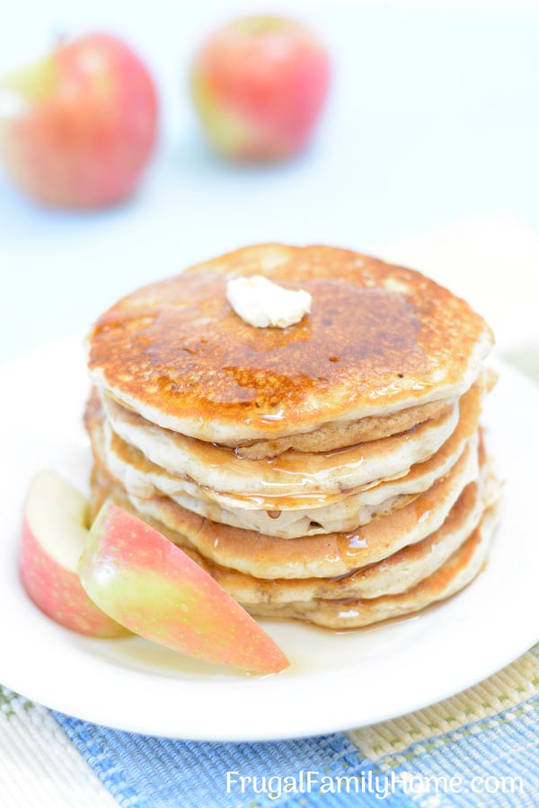 Apple cinnamon pancakes stacked on a plate