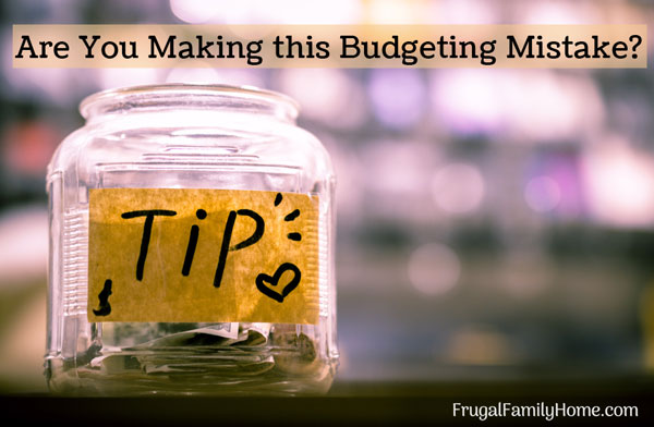 Budget tips jar on a desk.