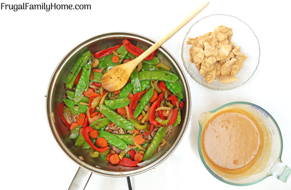 Skillet with stir fried vegetables, chicken and Thai Chicken sauce