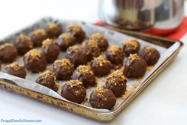 Truffles on the cookie sheet setting.