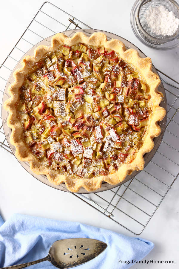 the rhubarb custard pie on cooling rack.