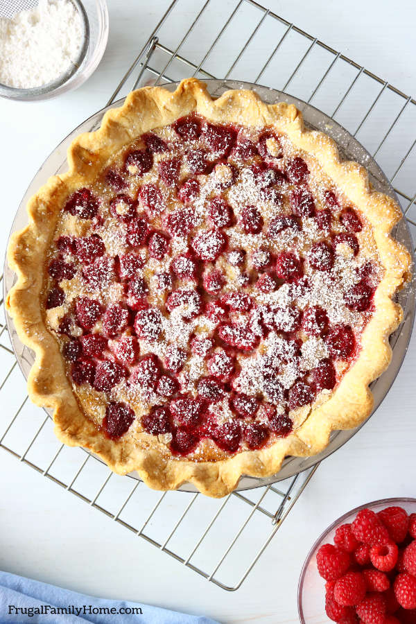 Raspberry custard pie recipe cooling on a rack