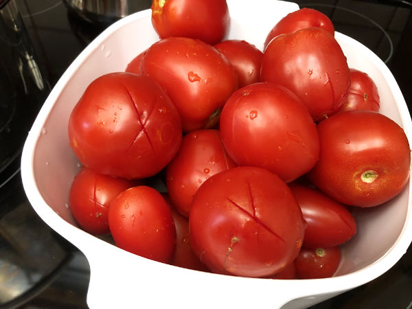 tomatoes scored with an x before canning.